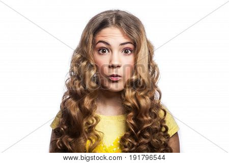 Portrait of amazed girl with wavy hairstyle and yellow t shirt. studio shot isolated on white background.