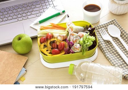Close up green Lunch box on work place of working desk Healthy eating clean food habits for diet and health care concept