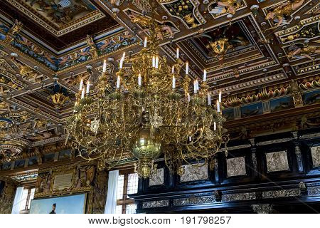 HILLEROD, DENMARK - JUNE 30, 2016: It is a chandelier of the Grand Knight's Hall of the Frederiksborg Castle.