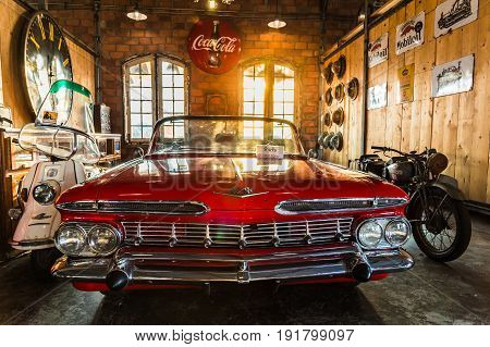 BANGKOK THAILAND - March 26 2017: Show old vintage red car at Night market Srinakarin road that name is train market. This market is open every Wednesday to sunday.