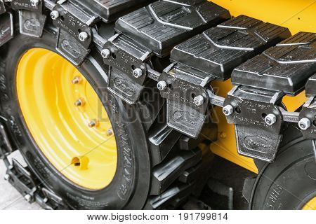 Moscow, Russia - may 30, 2017: pendant with rubber tractor tracks at the exhibition international specialized exhibition construction equipment and technologies CTT in Moscow