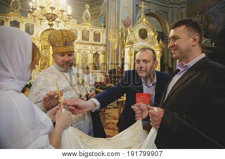 LUTSK UKRAINE - 26 March 2017: The ceremony of christening the little girl at church