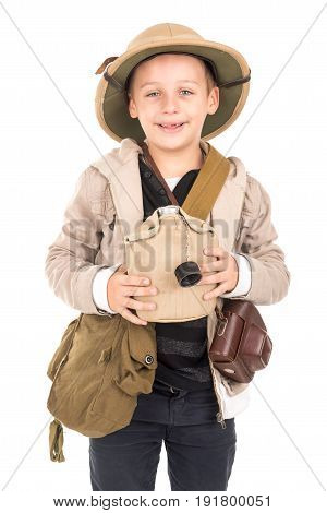 Young boy with canteen playing Safari isolated in white