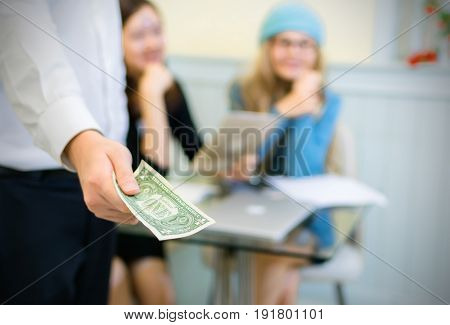 Businessman giving money cash payment and financial concepts