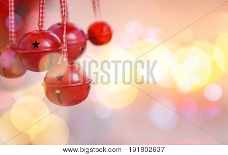 Jingle bells on blurred lights background, closeup. Concept of Christmas music and songs