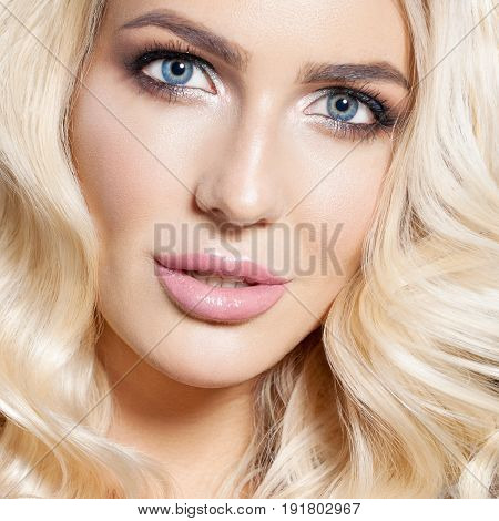 Portrait of beautiful blonde girl with healthy perfect clean skin, big blue eyes, long eyelashes. Natural look. Concept facial treatment