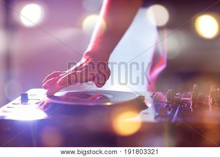 DJ performing in nightclub, closeup. Concept of Christmas music and songs