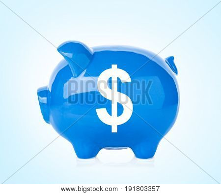 Piggy bank with symbol of dollar currency on color background. Financial savings concept