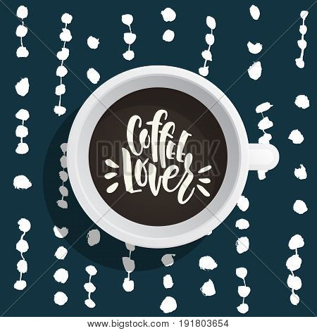 Lettering on the theme of coffee is hand-written. The phrase coffe lover written on the coffee Cup top view