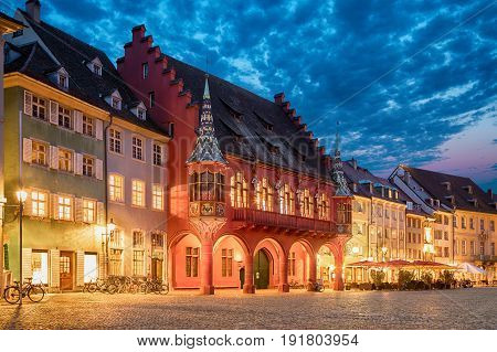 Historical building of Merchants Hall (Historisches Kaufhaus) built in 1520-21 and located on Munsterplatz squre in Freiburg Baden-Wurttemberg Germany