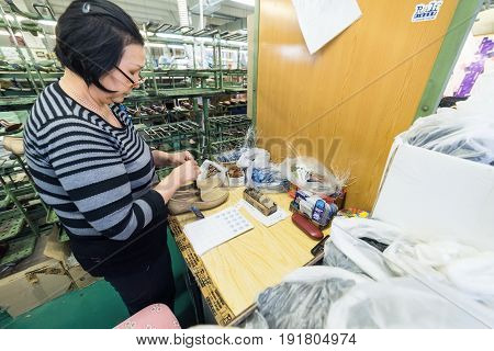 MOSCOW, RUSSIA - FEBRUARY 21, 2017: Moscow shoe factory JSC RALF RINGER. Female workers make shoes at a shoe factory.
