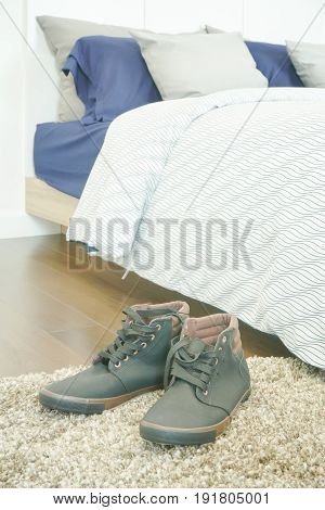 Men's Leather Shoe On Carpet Floor Next To Bed