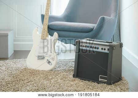 Guitar, Amplifier With Gray Armchair In Modern Style Living Room