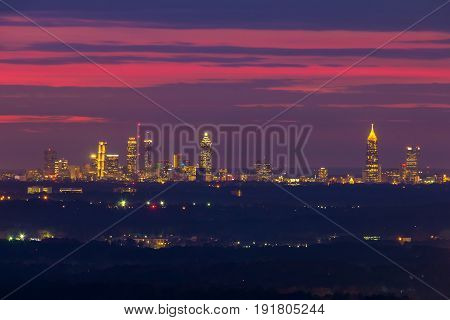 The beautiful view of illuminated Midtown Atlanta from the Stone Mountain at twilight with red sky Georgia USA
