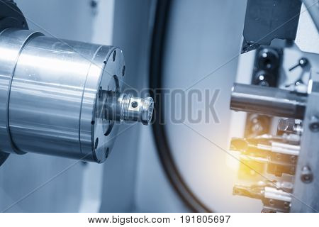 CNC lathe machine / Turning machine cutting the screw thread .Hi-precision CNC machining concept.