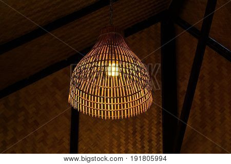 Lantern made of bamboo weave With a home in the Thai countryside.