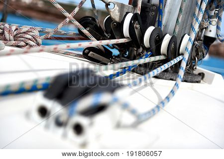 Blocks and ropes on a yacht mast