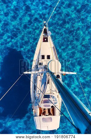 Yacht and clear Mediterranean sea view from the mast. Formentera. Balearic Islands. Spain