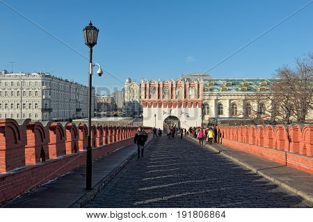 MOSCOW, RUSSIA - JANUARY 30, 2017: Moscow Kremlin view of the Kutafia Tower from one of the oldest stone bridge Troitsky (Rizopolozhensky) located above the Neglinnaya River (1516)