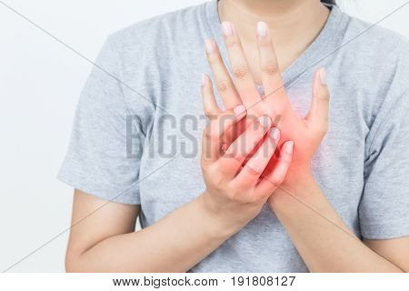 Young woman massaging her painful hand suffering from hand pain isolated on a white background