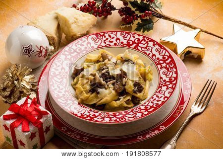 christmas italian ravioli with cheese flake and cep mushroom