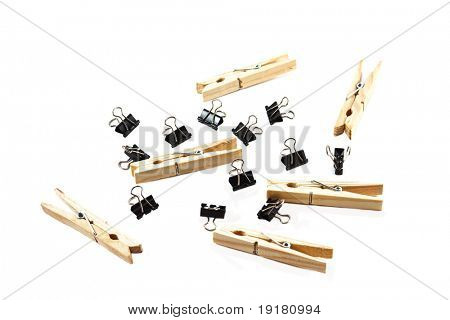 Binder clips and Wooden clothes pegs, isolated on white.