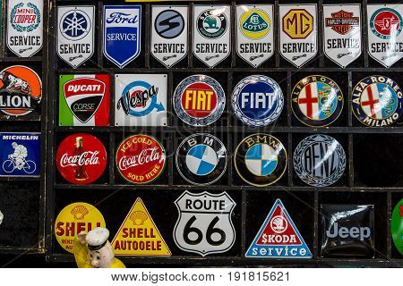 STUTTGART GERMANY - MARCH 03 2017: Souvenir magnets with logos of famous automotive brands oil companies and beverage producers. Europe's greatest classic car exhibition