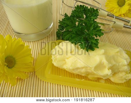 Homemade butter and drinking glass of buttermilk