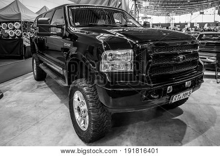 STUTTGART GERMANY - MARCH 03 2017: Full-size SUV Ford Excursion 2005. Black and white. Europe's greatest classic car exhibition