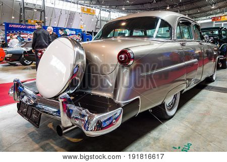 STUTTGART GERMANY - MARCH 03 2017: Mid-size luxury car Ford Mainline 1953. Rear view. Europe's greatest classic car exhibition
