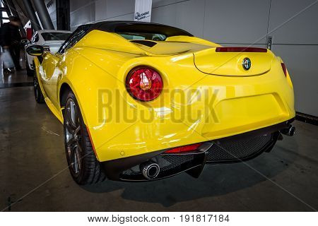 STUTTGART GERMANY - MARCH 03 2017: Sports car Alfa Romeo 4C Spider (Type 960) 2015. Rear view. Europe's greatest classic car exhibition