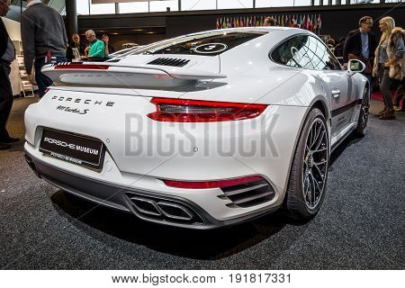 STUTTGART GERMANY - MARCH 03 2017: Sports car Porsche 911 Turbo S 2016. Rear view. Europe's greatest classic car exhibition