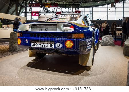 STUTTGART GERMANY - MARCH 03 2017: Sports car Porsche 959 Paris-Dakar 1986. Rear view. Europe's greatest classic car exhibition
