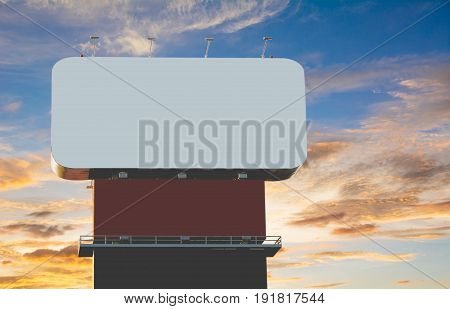 Blank billboard against under the blue with orange cloudy sky