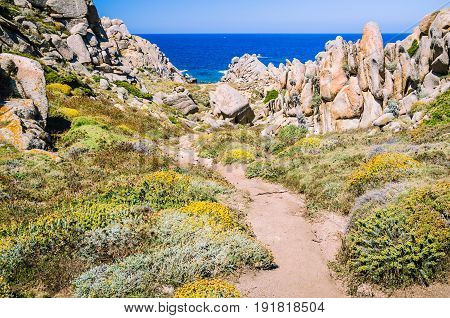 Walky path between bizarre granite rock formations in Capo Testa, Sardinia, Italy.