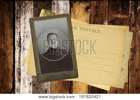 Vintage post cards and retro photo on old wooden planks. Inscription on the card -