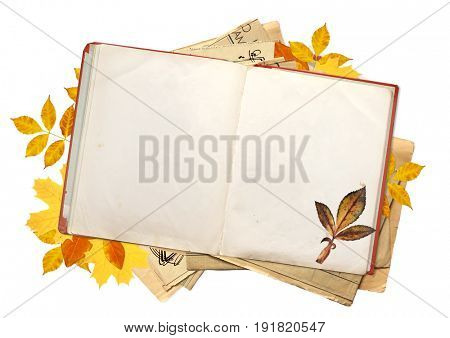 Old book with blank pages and multi-colored autumn leaves. Objects isolated on white background. Copy space for your text