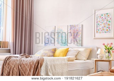 Interior of modern bedroom with cozy bed