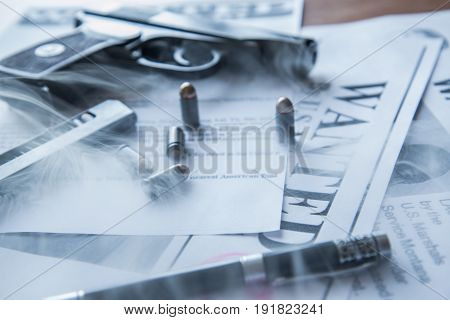 Ads on tracing criminals on the table of the bounty hunter, combat pistol, cartridges