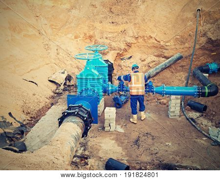 Worker Underground For Reconstrucion Of Drink Water System. Technical Expert At  Gate Valve
