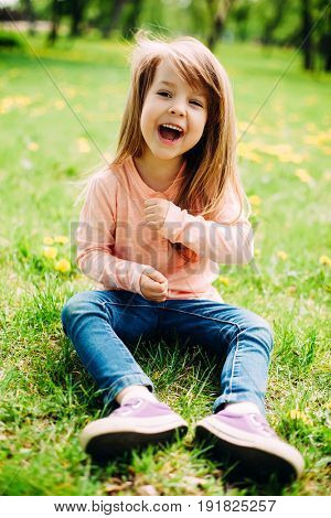 Sweet little girl outdoors with long hair