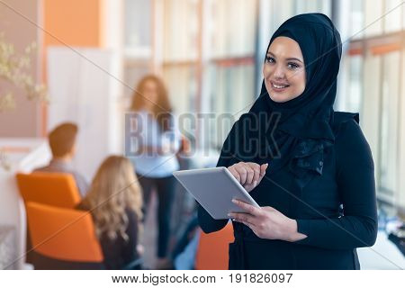 beautiful Arabian girl with tablet computer working at startup office.