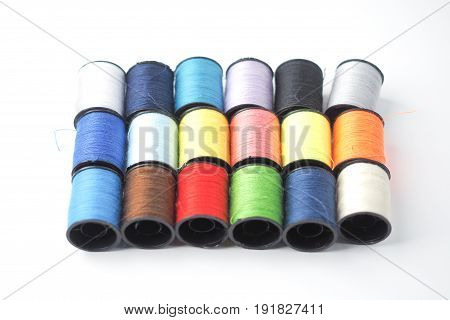 Colorful thread reels on white background, isolated