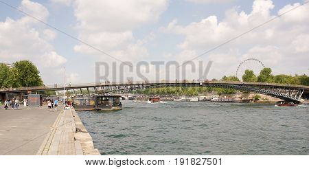 ParisFrance- April 29 2017: Bridge Leopold Sedar Senghor.Tourists stroll on the bridge and near the bridge