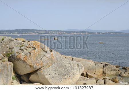 Big rocks at the coastline of the Island of La Toja in the province of Pontevedra Galicia Spain.