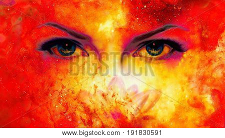 Woman eyes and lotus flower in cosmic background. Eye contact. Fire effect