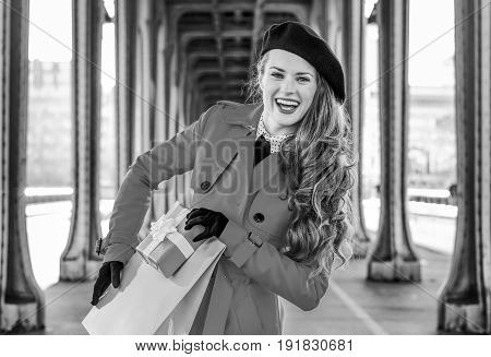 Woman In Paris Holding Shopping Bag And Christmas Present Box