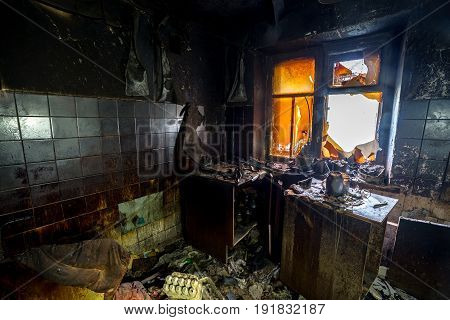 Burnt interiors of house after fire. Burned wooden furniture
