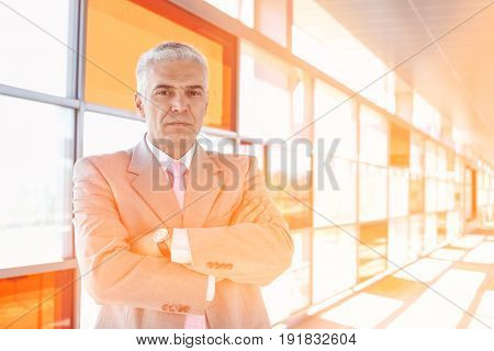 Portrait of confident middle aged businessman at railroad station