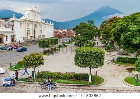 Antigua, Guatemala - September 7, 2009: Central park, cathedral & Agua volcano in colonial town & UNESCO World Heritage Site of Antigua, Guatemala
